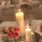 cropped-cylinders-with-candles-small-rose-bowls-with-flowers.jpg